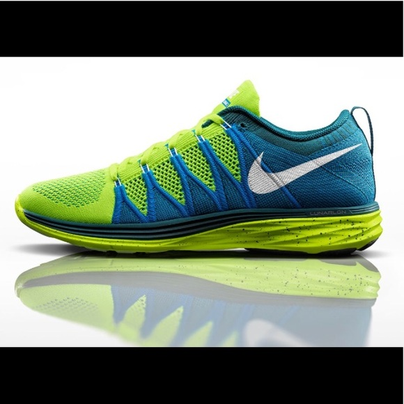 watch fe3ed c126b Neon Flyknit Lunar 2 Nike shoes.